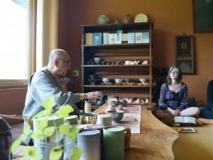 Monk Bumju speaking over tea