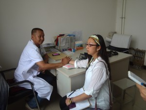 Mongolian doctor diagnosing the interviewer