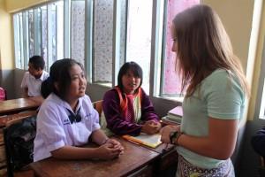 Woodrick interviews students in Thai school