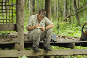 Joe Weirich takes field notes on a morning bird watching transect in Sorng Rokavorn (The Monks Forest).