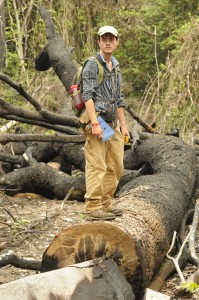 Joel Smith surveying the damage in an illegally logged area of Sangkrous Preychheu forest.