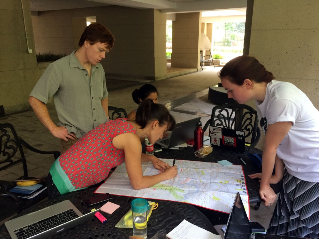 Early fieldwork site selection using a local Chongqing map to identify pre-selected sites using ESRI satellite imagery. Pictured: Kevin McGill, Melissa Y. Rock, Shirley Chen, and Aidan Mabey.