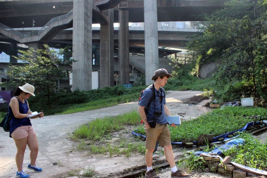 Joanne Zhao and Kevin McGill taking notes and observations at a fieldsite next to a Chongqing subway station.