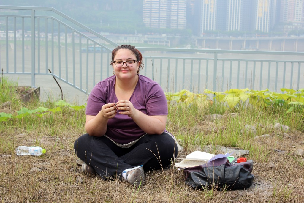 Melissa Iachetta conducts a soil analysis in a garden located next to a construction site.