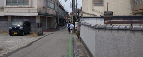 This photo shows the green painted line that guides pilgrims (henro) from the local train station to the gate of Temple 1.
