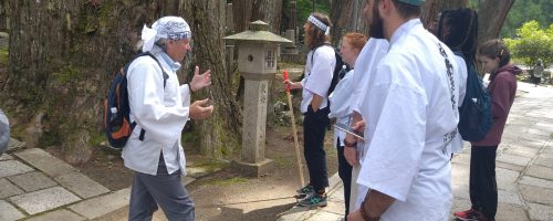 This photos shows Dr. Ron Green discussing the history and importance of the Koyasan cemetery with CCU students Luke Rutherford, Kasey Charette, Jacob Brine,Wyatt Beard, Shonte Clement, and Varyck Clayton.