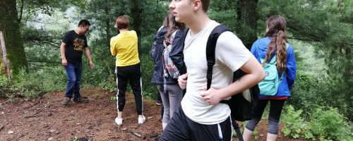 Slippery Rock University team checked an extinguished campfire site in a forest area in Luliang
